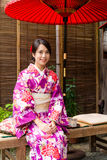 Japanese woman relaxing in tea house Royalty Free Stock Image