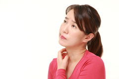 Japanese woman scratching her neck Stock Images