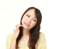 Japanese woman scratching her neck Royalty Free Stock Photos