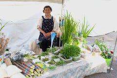 Japanese woman sells vegetables morning market, Takayama, Japan Royalty Free Stock Images