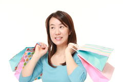 Japanese woman with shopping bags Stock Photography