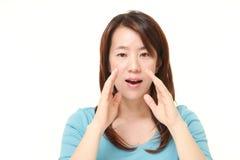 Japanese woman shout something. Studio shot of Japanese woman on white background Stock Image