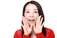 Japanese woman shout something. Studio shot of young Japanese woman on white background stock photography