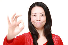 Japanese woman showing perfect sign Royalty Free Stock Photos
