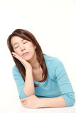 Japanese Woman Sleeping on the Table Stock Image