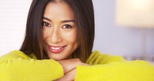 Japanese woman smiling and looking at camera Royalty Free Stock Photo