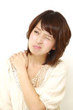 Japanese woman suffers from neck ache Royalty Free Stock Photo