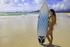 Japanese woman with surfboard Stock Photos