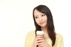 Japanese woman takes a coffee break Stock Images
