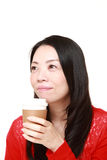 Japanese woman takes a coffee break Royalty Free Stock Photography
