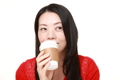 Japanese woman takes a coffee break Stock Photo