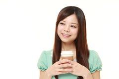 Japanese woman takes a coffee break Royalty Free Stock Photos