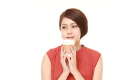 Japanese woman takes a coffee break Stock Photo