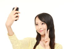 Japanese woman takes a selfie Stock Photos