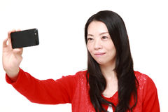 Japanese woman takes a selfie Royalty Free Stock Image