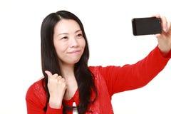 Japanese woman takes a selfie Royalty Free Stock Photo