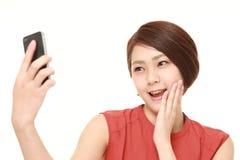Japanese woman takes a selfie royalty free stock photos