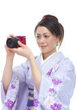 Japanese woman taking photos Stock Image