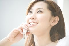 Japanese woman talking with cell phone Royalty Free Stock Image