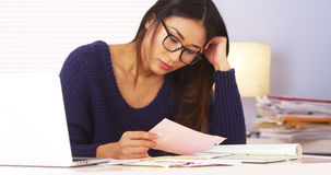 Japanese woman tired of doing paperwork Royalty Free Stock Images