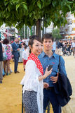 Japanese woman tourist dressed in traditional costumes at the Seville's April Fair. Royalty Free Stock Image