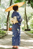 Japanese woman in traditional dress Stock Photography