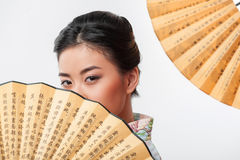 Japanese woman with traditional fan Royalty Free Stock Photos