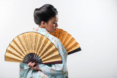 Japanese woman with traditional fan Royalty Free Stock Photo