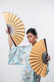 Japanese woman with traditional fan Stock Photography