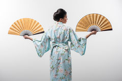 Japanese woman with traditional fan Royalty Free Stock Image
