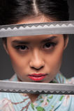 Japanese woman with two katanas Stock Photos