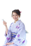 Japanese woman using smart phone Royalty Free Stock Image