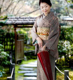 Japanese woman wearing kimono Stock Images