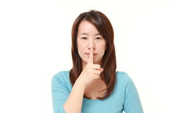 Japanese woman whith silence gestures Stock Photos