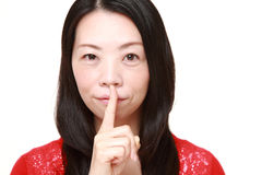 Japanese woman whith silence gestures Royalty Free Stock Images