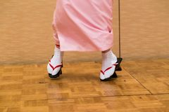 Japanese women dancing in traditioanl dress and geta shoes royalty free stock images