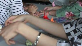 Japanese women hands folding Japanese paper origami stock video