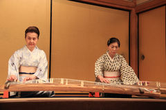 Japanese women with Japanese stringed musical instrument. Stock Photo