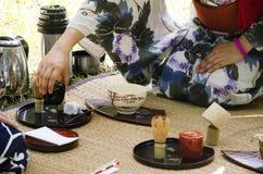 Japanese women making sado chanoyu or Japanese tea ceremony, also called the Way Royalty Free Stock Image
