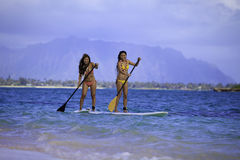 Japanese women on paddleboards Stock Images