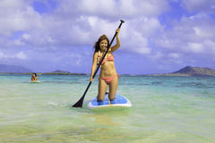 Japanese women on paddleboards Stock Photography