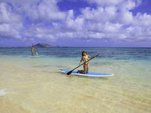 Japanese women on paddleboards Royalty Free Stock Photography