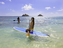Japanese women on paddleboards Stock Photo