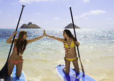 Japanese women on paddleboards Royalty Free Stock Photos