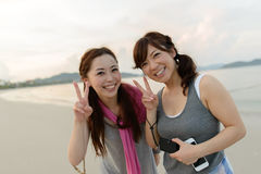 Japanese women posing on the beach Royalty Free Stock Photos