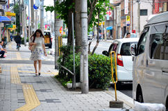 Japanese women walking to subway station Stock Photo