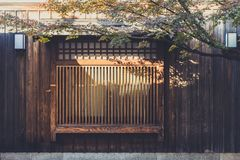 Japanese wood window art traditional architecture. Vitnage color tone stock photo