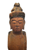 Japanese wooden Buddha statue isolated. Ancient Japanese carved natural wooden Buddha statue, with many wormholes.  Isolated on white Royalty Free Stock Image
