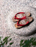 Japanese wooden sandal. On the stone Stock Images