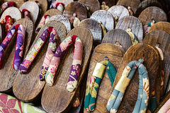 Japanese wooden slippers on a market Stock Images